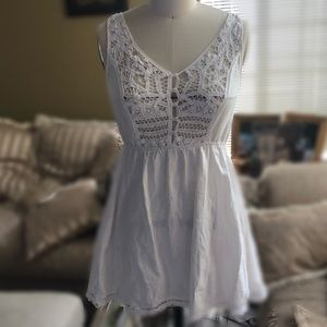 White dress with croquette trim
